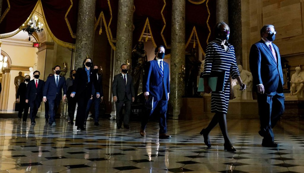 Democratic House impeachment managers walk through Statuary Hall in the Capitol to deliver to the Senate an article of impeachment against former President Donald Trump on Jan. 25, 2021. (AP)