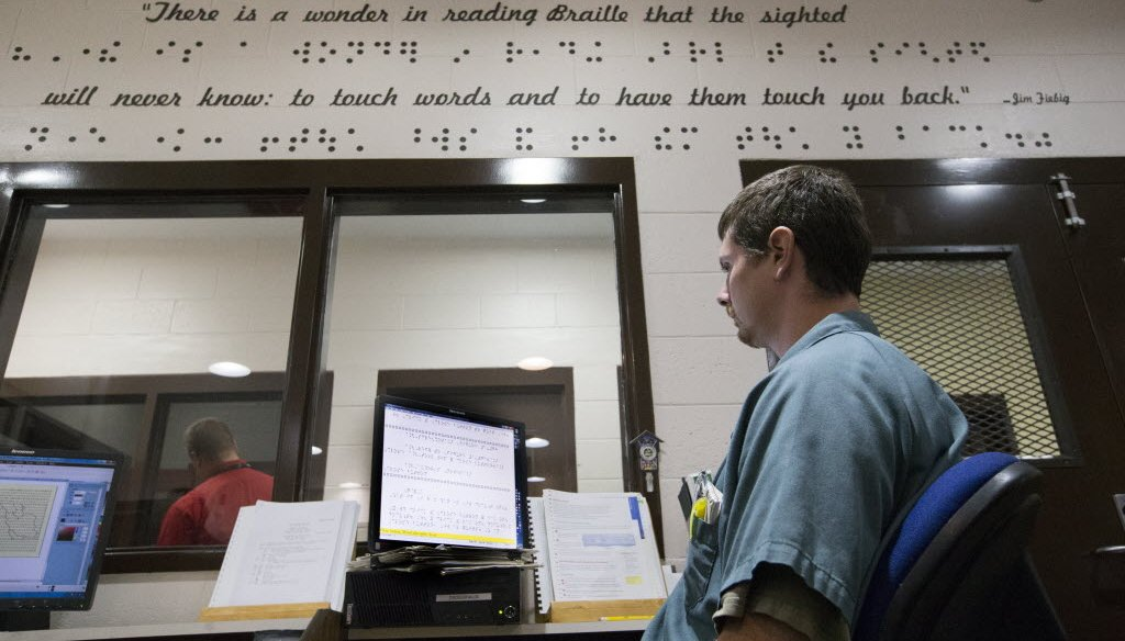 An inmate proofreads his work while transcribing books into braille for the blind at the Oshkosh Correctional Institution in Oshkosh, Wis. (Milwaukee Journal Sentinel/Mark Hoffman)