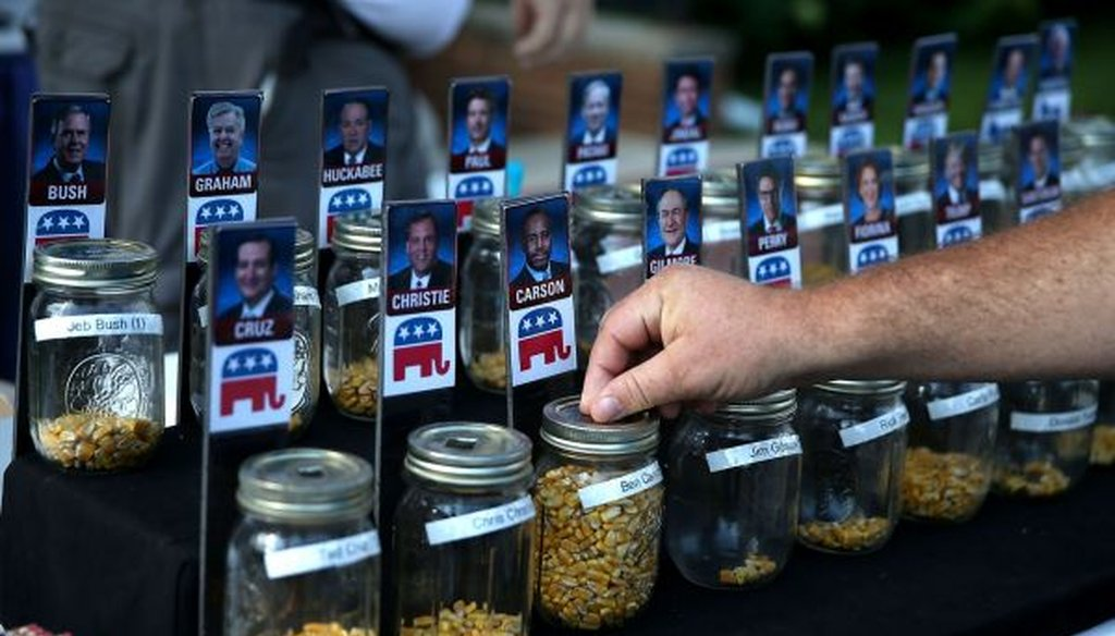 A fairgoer places a vote for Republican presidential hopeful Ben Carson during the Iowa State Fair on Aug. 14, 2015, in Des Moines. (Justin Sullivan/Getty Images)