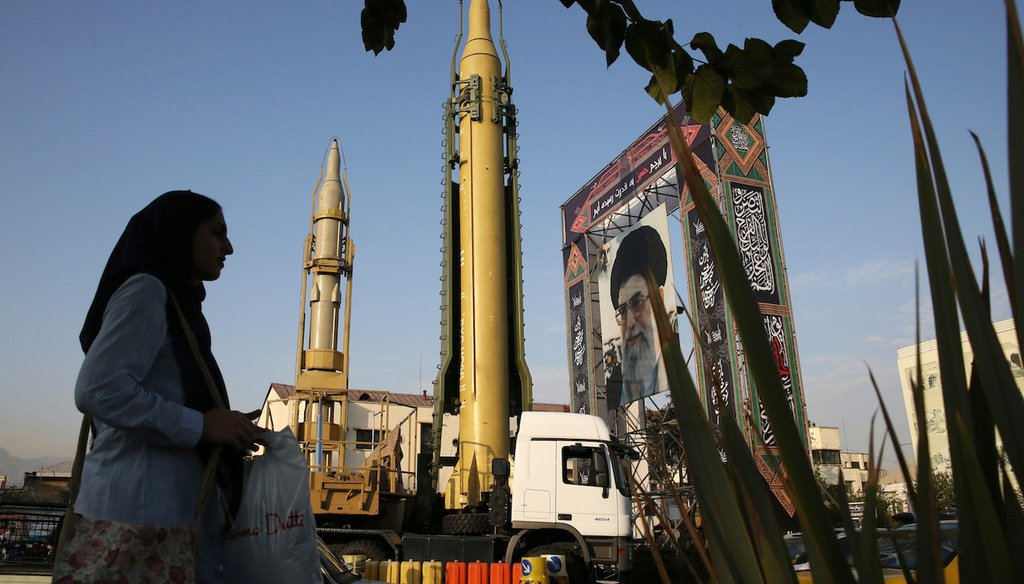 In this Sept. 24, 2017 AP file photo, a Ghadr-H missile, center, a solid-fuel surface-to-surface Sejjil missile and a portrait of the Supreme Leader Ayatollah Ali Khamenei are displayed at Baharestan Square in Tehran, Iran.
