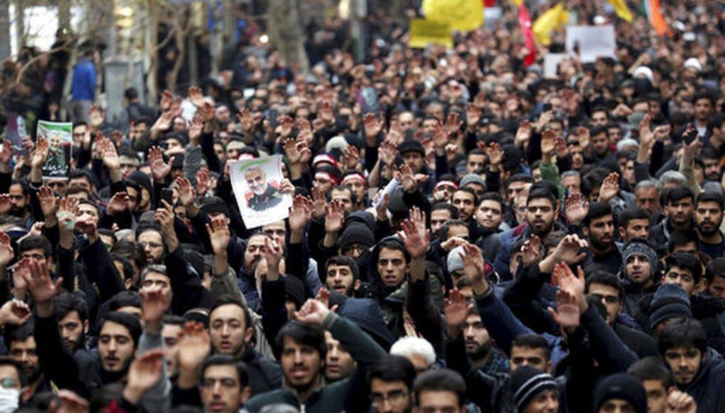 Protesters demonstrate over the U.S. airstrike in Iraq that killed Iranian Revolutionary Guard Gen. Qassem Soleimani in Tehran, Iran. (AP)