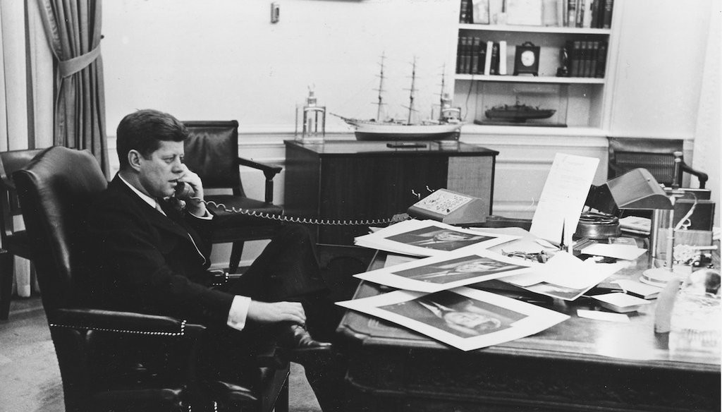 President John F. Kennedy is shown as he ends his official day after 7:30 pm with a final phone call to his press secretary from his Oval Office desk at the White House in Washington, D.C., March 16, 1961. (AP)