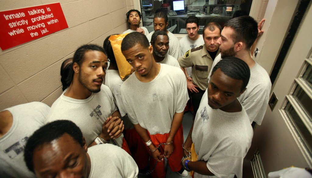 Inmates arriving from the House of Correction wait for a door to open before heading to the court staging area at the Milwaukee County Jail. They were scheduled for afternoon court hearings. (Mark Hoffman photo)