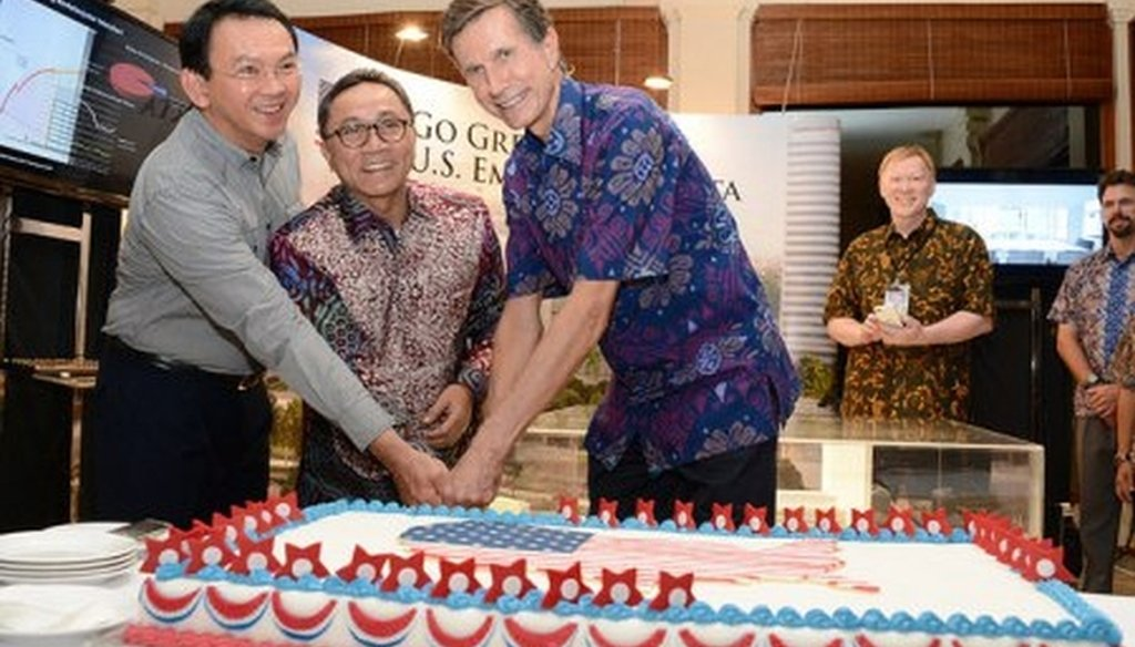 A July 4th celebration at the U.S. Embassy in Jakarta's featuring Amb. Robert O. Blake, guests, and a red, white and blue cake. (State Department/Erik A. Kurniawan)
