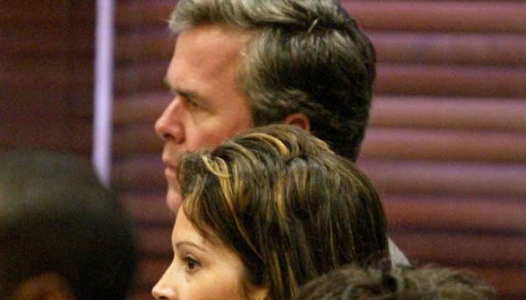 Noelle Bush, center, stands in front of her father, then-Florida Gov. Jeb Bush, during her final appearance in drug court on Aug. 8, 2003, in Orlando, Fla. (AP/Scott Audette)