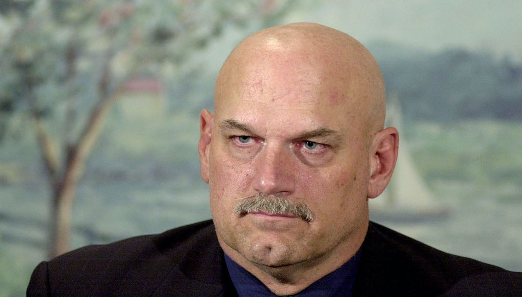 A recent Facebook post used a video featuring former Minnesota Gov. Jesse Ventura, seen here in a file photo from December 2001,  to claim the COVID-19 pandemic was planned. We rate the claim Pants on Fire! (AP)