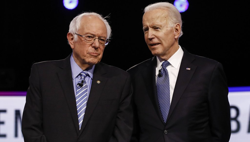 Democratic presidential candidates, Sen. Bernie Sanders, I-Vt., and former Vice President Joe Biden talk before a primary debate, Feb. 25, 2020, in Charleston, S.C. (AP)