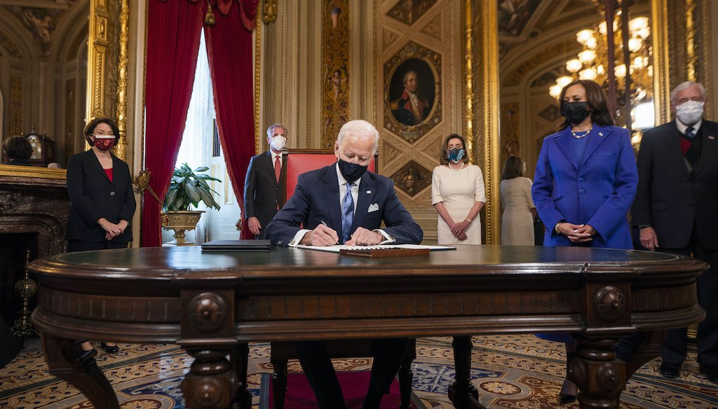 President Joe Biden signed three documents at the U.S. Capitol shortly after being inaugurated on Jan. 20, 2021. Vice President Kamala Harris is at Biden's left. (AP)