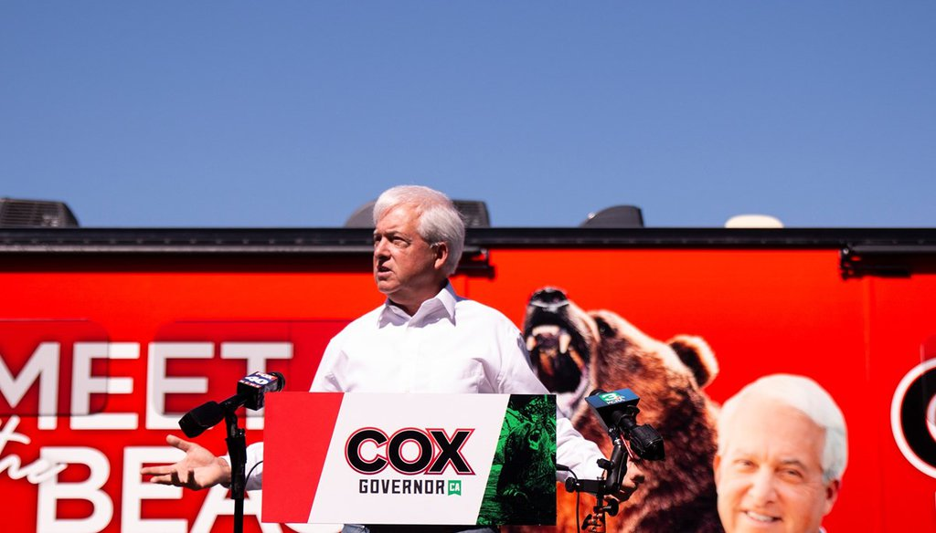 John Cox, Republican gubernatorial candidate in California, launched his official campaign bus tour for the upcoming recall election as an actor bear named Tag walked around behind him in Sacramento on May 4, 2021. Kris Hooks / CapRadio