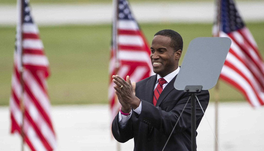Senate candidate John James speaks during a President Donald Trump rally at the MBS International Airport in Freeland on Sept. 10, 2020. (Mandi Wright, Detroit Free Press)