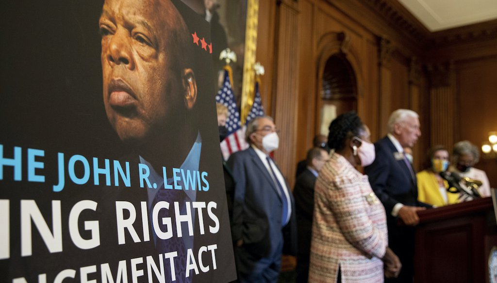 A poster bearing the image of voting rights icon John Lewis is seen during a news conference after the House of Representatives passed the The John Lewis Voting Rights Advancement Act in Washington, on Capitol Hill in Washington, on Aug. 24, 2021. (AP)