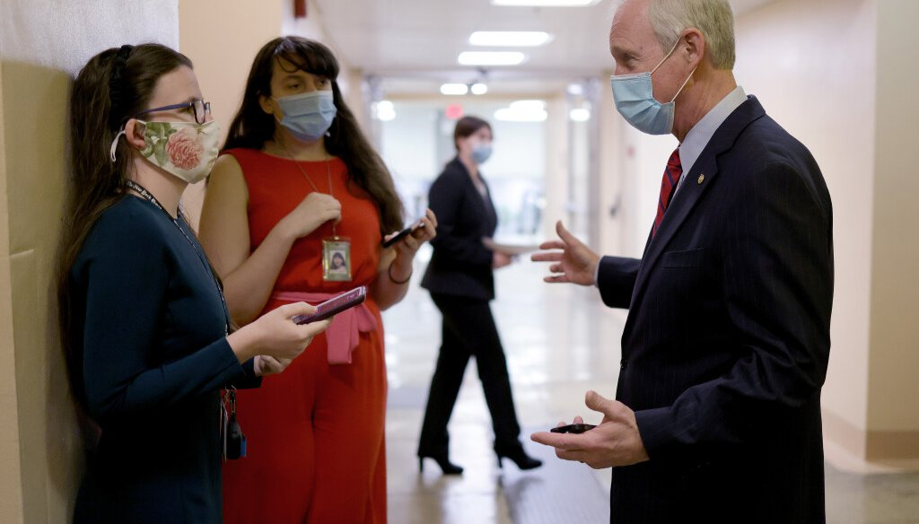 Sen. Ron Johnson (R-WI) talks with reporters while walking to the U.S. Senate chamber for a vote March 05, 2021 in Washington, DC. The Senate continues to debate the latest COVID-19 relief bill. (Photo by Win McNamee/Getty Images)