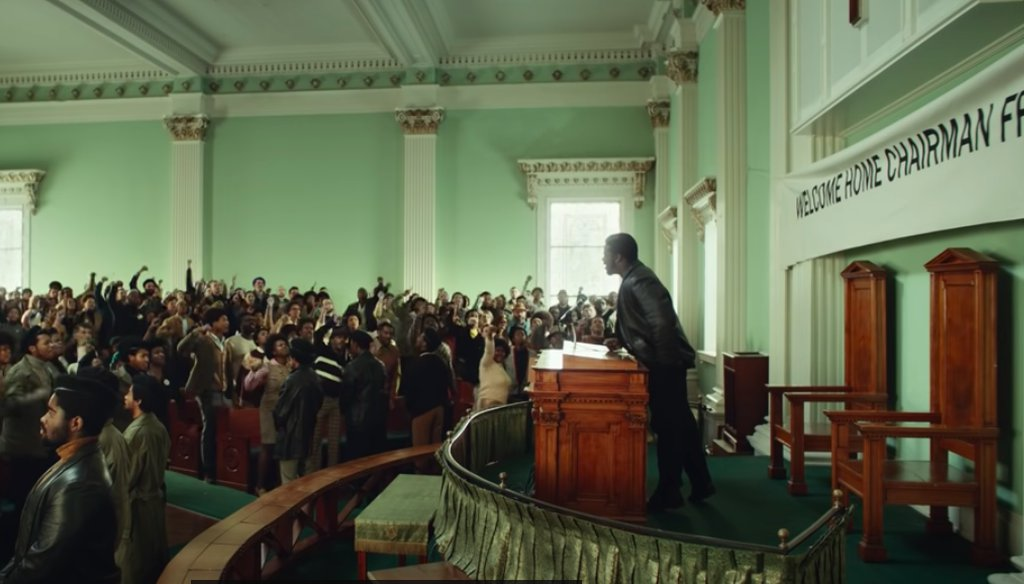"""Black Panther leader Fred Hampton, played by Daniel Kaluuya, leads a rally in Chicago in a scene from """"Judas and the Black Messiah"""" from Warner Bros. Pictures. (Screenshot)"""