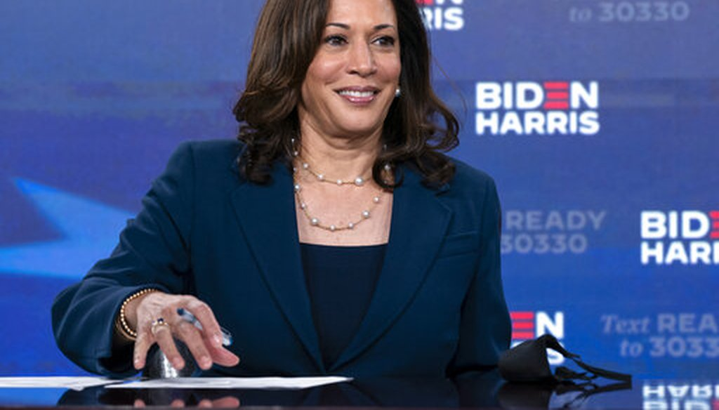 Democratic presidential candidate former Vice President Joe Biden's running mate Sen. Kamala Harris, D-Calif., looks up as she signs required documents for receiving the Democratic nomination for President and Vice President of the United States in Wilmin