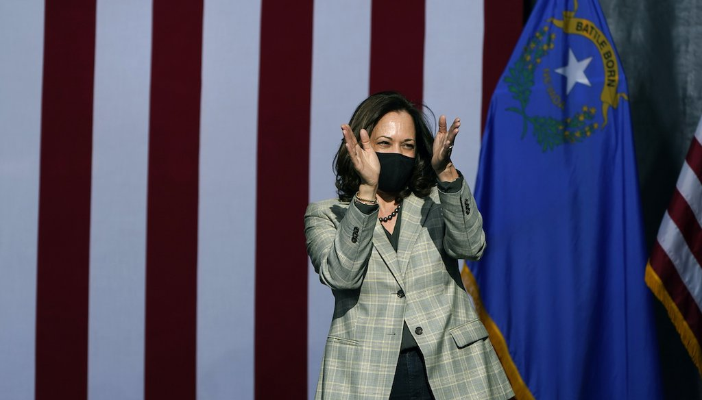 Democratic vice presidential candidate Sen. Kamala Harris, D-Calif., reacts after speaking at a drive-in campaign event Friday, Oct. 2, 2020, in Las Vegas. (AP Photo/John Locher)