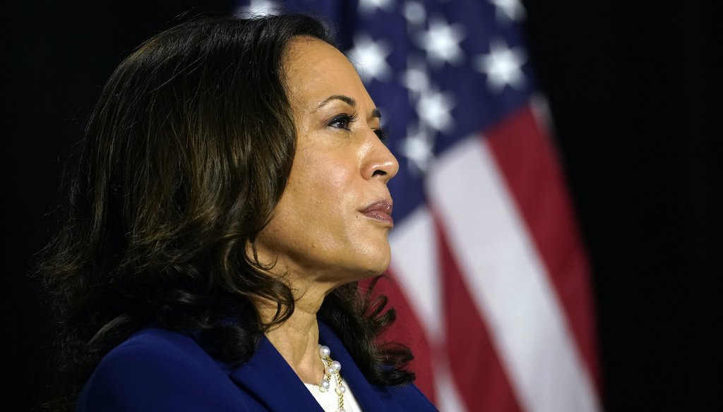 Sen. Kamala Harris, D-Calif., listens as Democratic presidential candidate former Vice President Joe Biden introduces her as his running mate at Alexis Dupont High School in Wilmington, Del., Wednesday, Aug. 12, 2020. (AP)