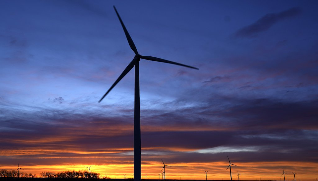Wind turbines silhouetted against the sky at dawn near Spearville, Kan. (AP)