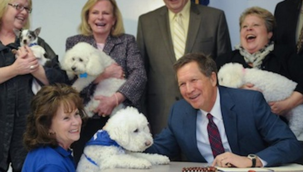 Photo from John Kasich's gubernatorial campaign shows him signing legislation imposing restrictions on puppy mills and large-scale breeders, in 2013