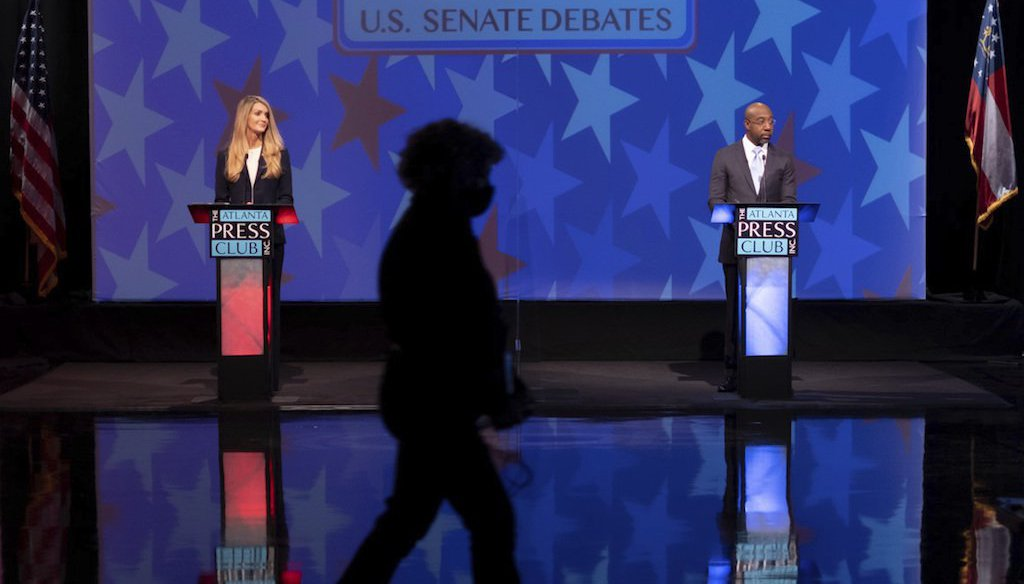 Sen. Kelly Loeffler, R-Ga., and the Rev. Raphael Warnock, her Democratic challenger in a Jan. 5, 2021, runoff election, at a debate in Atlanta on Dec. 6, 2020. (AP)