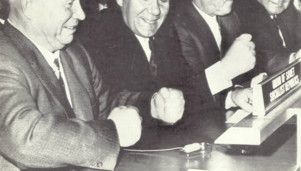 Soviet Premier Nikita Khrushchev pounds his fist on the desk while seated with his delegation a few days before he was reputed to have used his shoe to bang on the desk during a meeting at the United Nations.