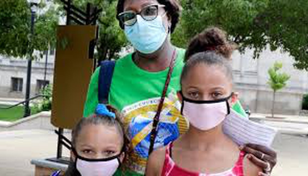 Jerrilyn Johnson of Racine and granddaughters Dalani Finley, 7, and Dailynn Finley, 10, are masked while out and about Saturday, Aug. 1, 2020, the first day of Gov. Tony Evers' mandate requiring them to be worn indoors. (Rick Wood/Milw. Journal Sentinel)l