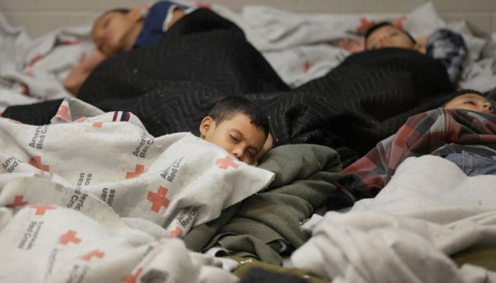 Detainees sleep in a holding cell at a U.S. Customs and Border Protection processing facility on June 18, 2014, in Brownsville,Texas. (AP/Eric Gay)
