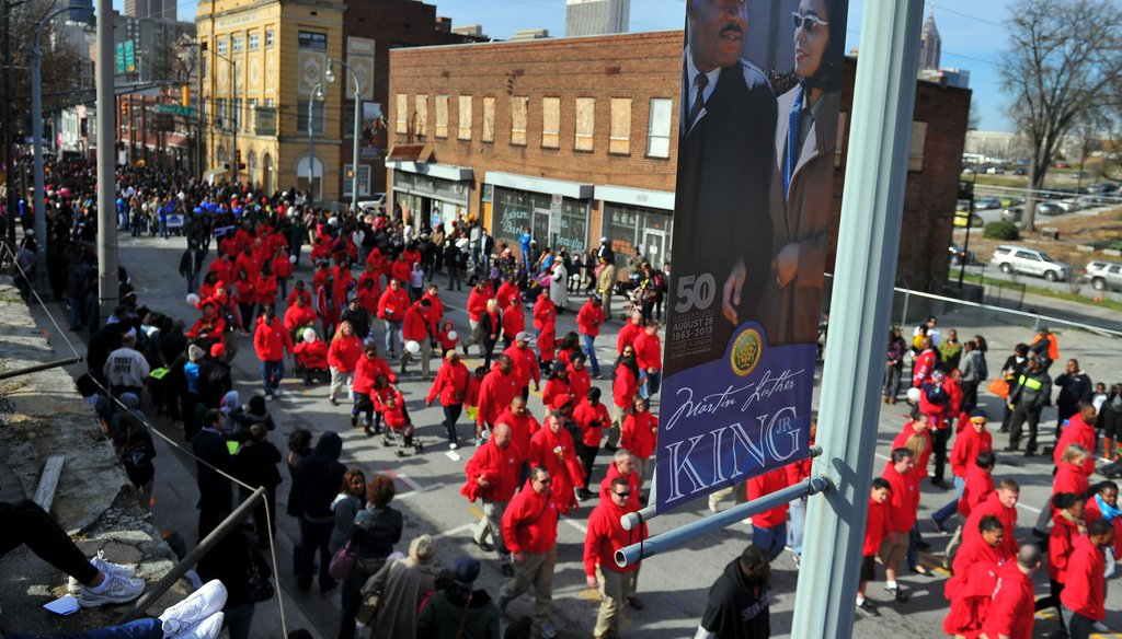 Atlanta, the birthplace of the Rev. Martin Luther King Jr., holds an annual parade to celebrate the federal holiday commemorating his birthday. Here, marchers walk the parade route for the 2013 celebration. Photo credit: Brant Sanderlin/AJC
