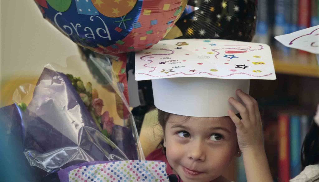 """Zoe Betancourt wore a """"Grad Princess"""" sash to her pre-K graduation at Aversboro Elementary School in Garner, NC, in June 2016 where she also got flowers and a balloon. News & Observer photo."""