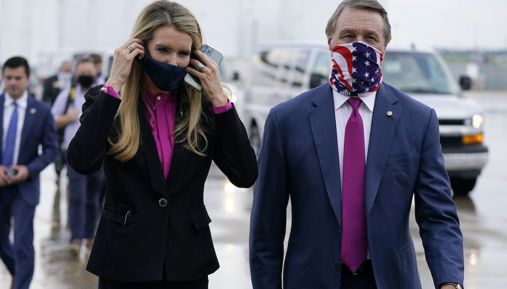 U.S. Sens. Kelly Loeffler and David Perdue, both Georgia Republicans, are shown at UPS Hapeville Airport Hub in Atlanta on July 15, 2020. They called on the GOP Georgia secretary of state to resign in the wake of the Nov. 3, 2020, elections. (AP)