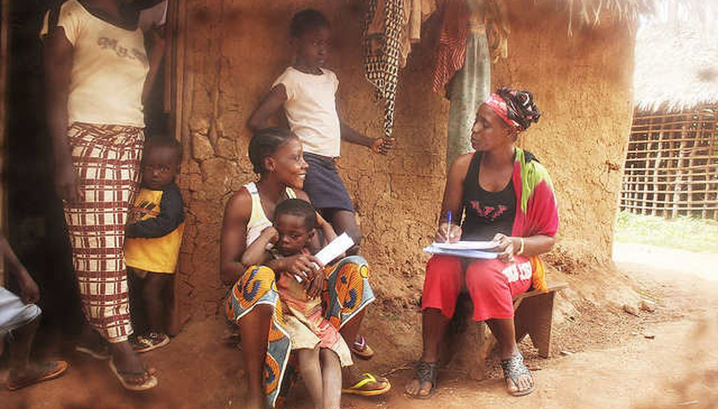 A health care workers interviews residents in Billibo, Liberia, a country that lacks key data on poverty. (Direct Relif, via Flickr Creative Commons)