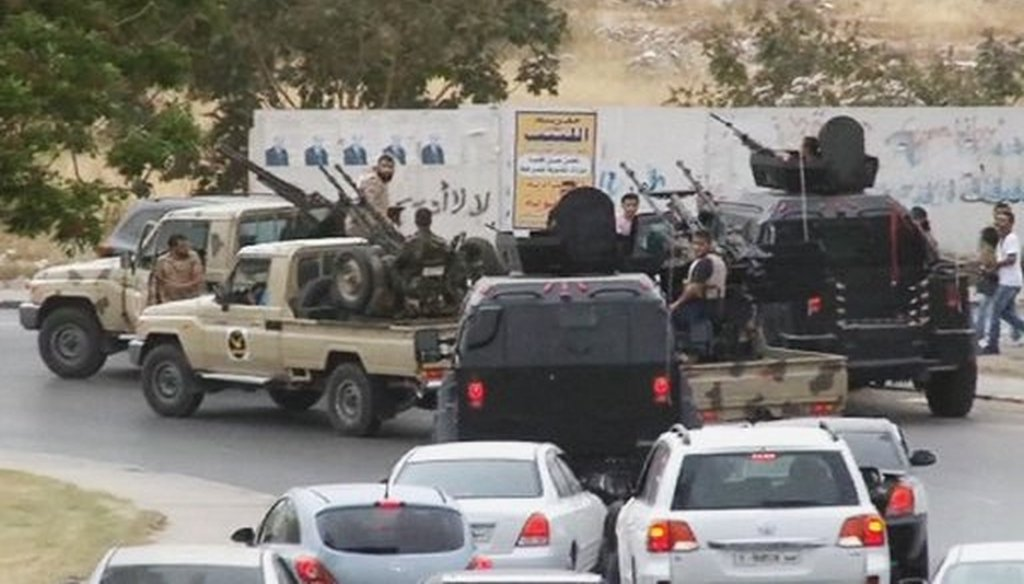 Vehicles with heavy artillery of the Tripoli joint security forces move closer to Libya's parliament after troops of Gen. Khalifa Hifter targeted Islamist lawmakers and officials, on May 18, 2014. (AP/Libyan national army)