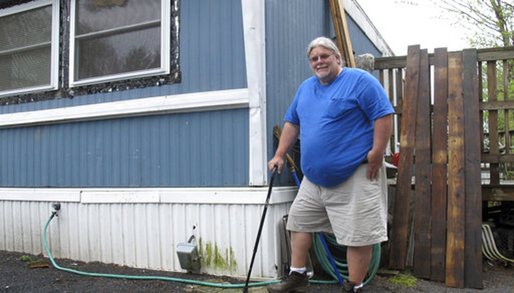 In this May 2, 2017 photo, Todd Alexander poses at his mobile home in Milton, Vt., that he heats with the help of the Low Income Home Energy Assistance Program. (AP)