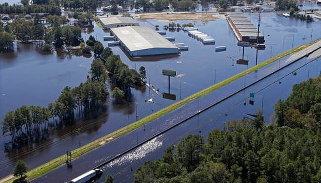 A stretch of I-95 in Lumberton, N.C., was flooded along with nearby buildings after Hurricane Matthew hit the state. Raleigh News & Observer photo.