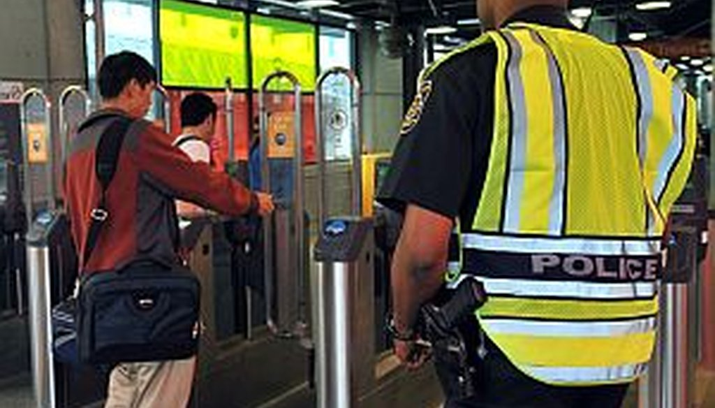 A MARTA police officer patrols Lindbergh Center station. A transit official says the system is getting safer. Crime stats tell a more nuanced story.