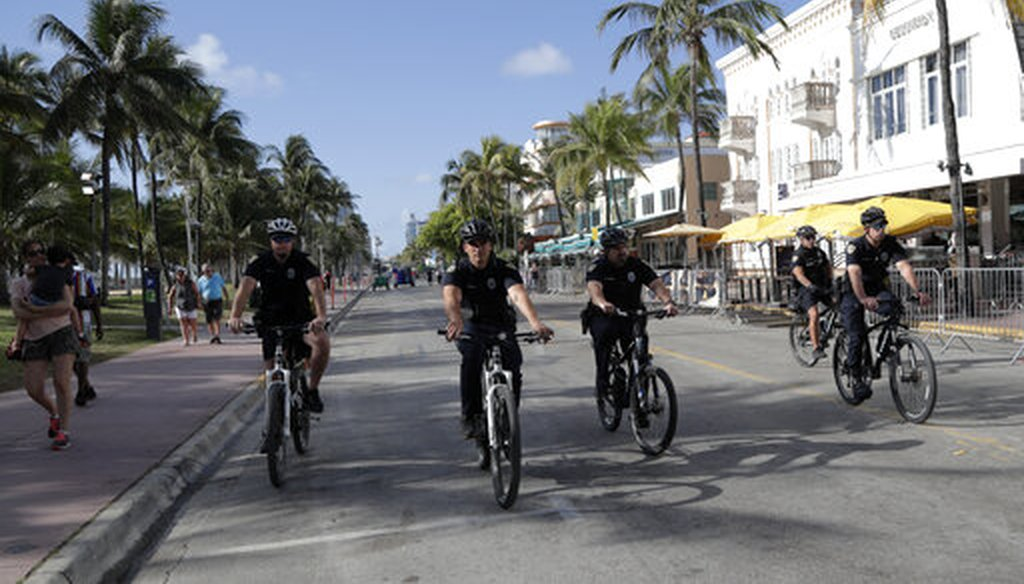 Miami Beach police officers patrol on Ocean Drive March 15, 2020, in Miami Beach, Fla. (AP)