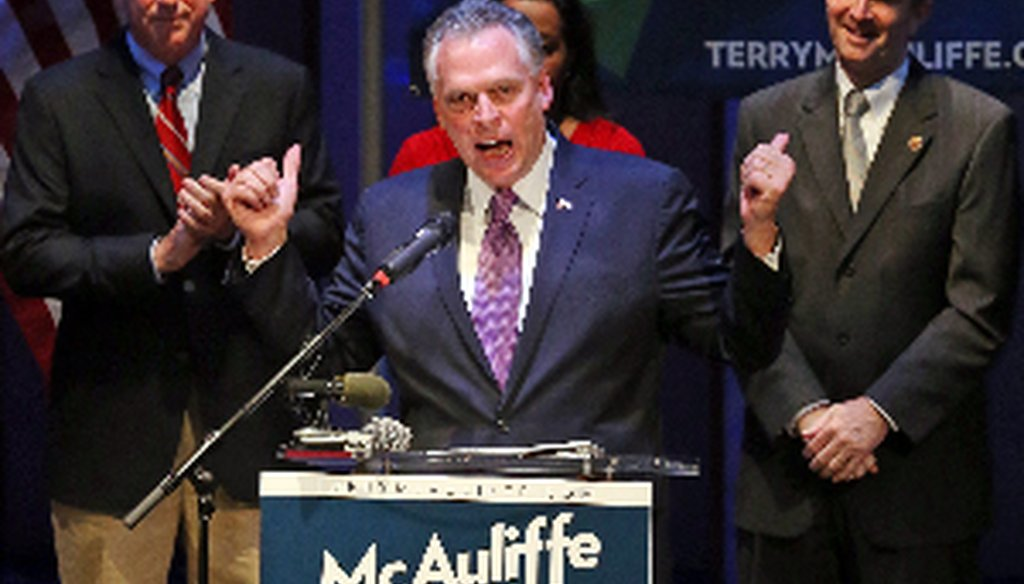 Democratic gubernatorial candidate Terry McAuliffe, center, at a June 12 Richmond campaign rally with his running mates, Mark Herring, left, and Ralph Northan, right.