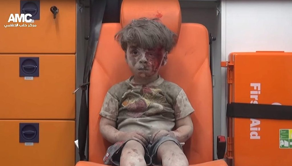 A screenshot from a handout video from Syrian activist group Aleppo Media Center (AMC) shows a 4-year-old boy with a bloodied face sitting in an ambulance after a house was destroyed in an airstrike on Aug. 17, 2016, in Aleppo. (MCT)
