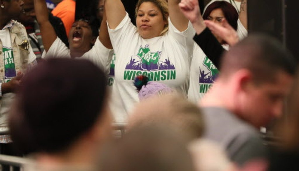 Supporters of raising Wisconsin's minimum wage from $7.25 to $15 an hour demonstrate during an Oct. 22, 2018, University of Wisconsin -- Milwaukee rally featuring Sen. Bernie Sanders. (Michael Sears / Milwaukee Journal Sentinel.)