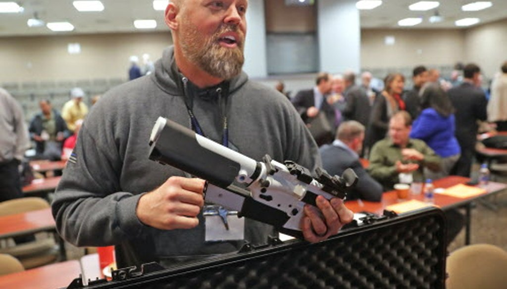 Will Murphy, president of Gun Guardian, talks about an AR 15 rifle with a prototype trigger shield during the Firearm Safety Expo at Milwaukee Area Technology College in Oak Creek Jan. 16, 2019.  Mike De Sisti / Milwaukee Journal Sentinel