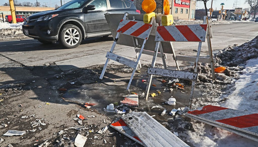 Barricades were placed to try and prevent drivers from hitting a large pothole near 272 E. Capitol Drive in Milwaukee on Feb. 22, 2019. (Michael Sears/Milwaukee Journal Sentinel).