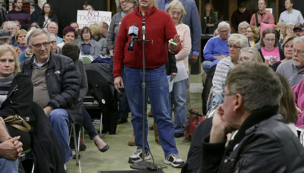 """Residents of Paul Ryan's congressional district in southeast Wisconsin speak at a """"town hall"""" meeting organized by the group Forward Kenosha. Ryan did not attend the event. (Mike De Sisti)"""