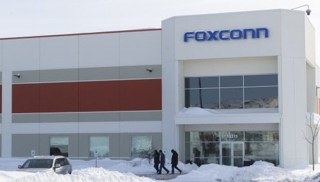 A group exits a Foxconn building Jan. 31, 2019, on Globe Drive in Mount Pleasant, Wis. (Mark Hoffman / Milwaukee Journal Sentinel.)
