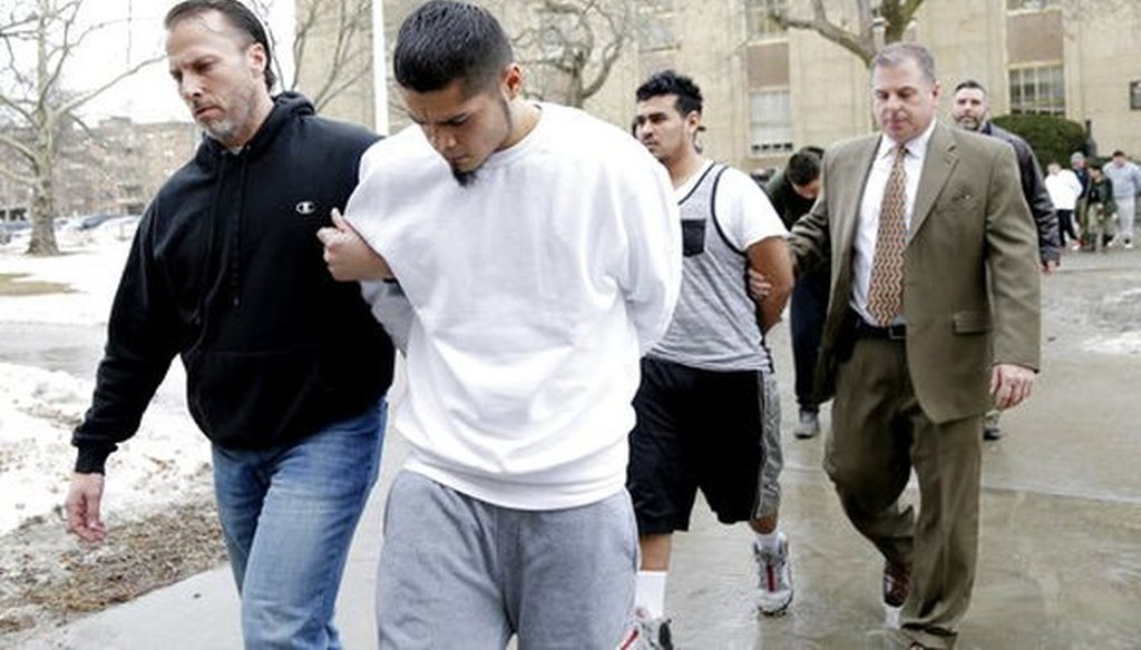 Suspected members of the MS-13 gang are escorted to their arraignment in Mineola, N.Y., on Jan. 11, 2018. (AP Photo/Seth Wenig)