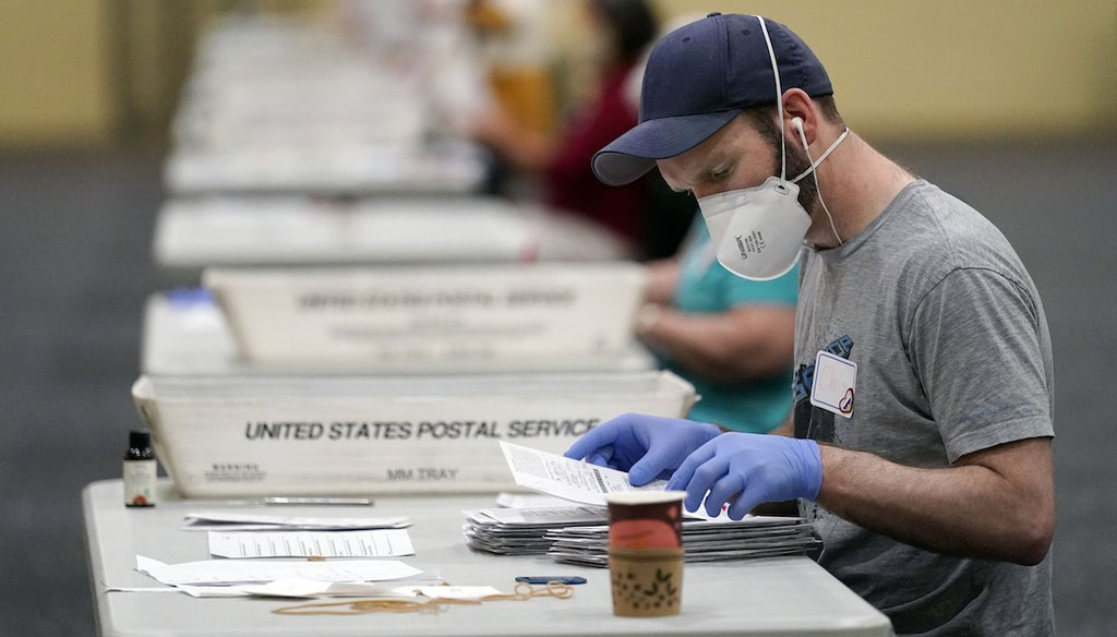 Workers prepare mail-in ballots for counting in Lancaster, Pa. (AP Photo/Julio Cortez)