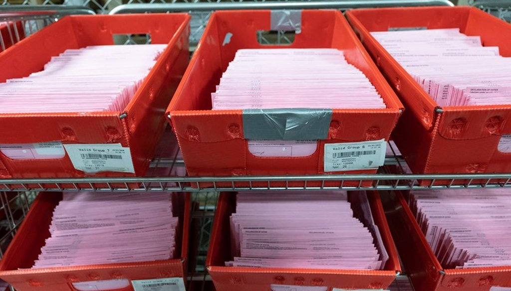 Vote-by-mail ballots wait to be opened at the county registrar's office in Sacramento, Calif., on March 3, 2020. Andrew Nixon / CapRadio