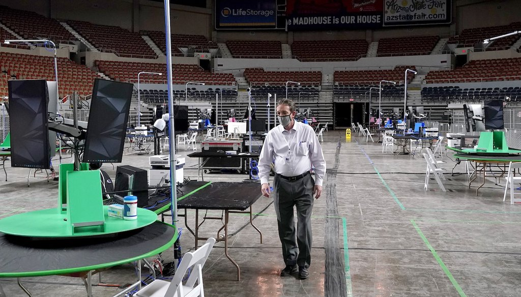 Former GOP Arizona Secretary of State Ken Bennett walks inside the Arizona Veterans Memorial Coliseum on April 22, 2021, during setup for an audit of the county's 2020 presidential election results. The audit was ordered by the GOP-led state Senate. (AP)