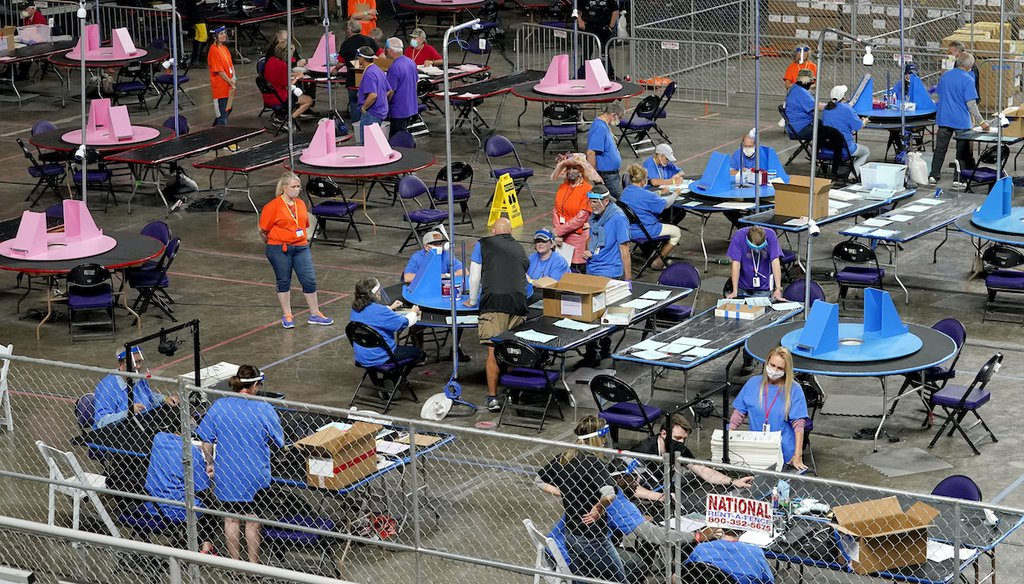 This May 6, 2021, photo shows contractors for Florida-based Cyber Ninjas examining and recounting Maricopa County, Arizona's 2020 general election ballots at Veterans Memorial Coliseum in Phoenix. (AP)