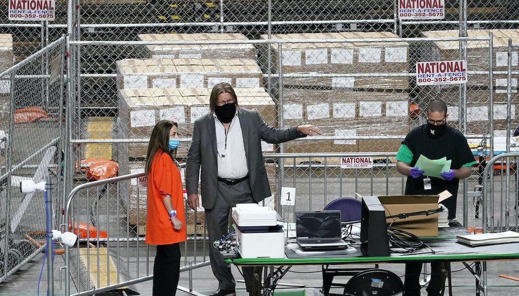 Maricopa County ballots cast in November are being recounted by contractors under a recount launched by the Arizona State Senate at Veterans Memorial Coliseum in Phoenix,  April 29. (Arizona Republic via AP)