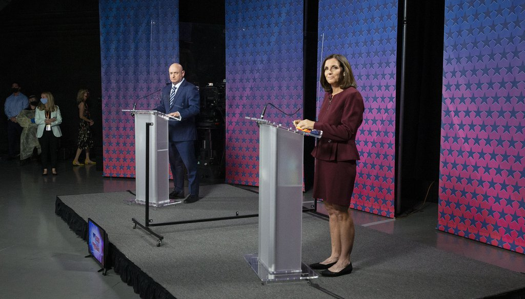 Democratic challenger Mark Kelly, left, and Republican U.S. Sen. Martha McSally are separated by plexiglass as they participate in a debate, Oct. 6, 2020 in Phoenix. (Rob Schumacher/The Arizona Republic via AP, Pool)