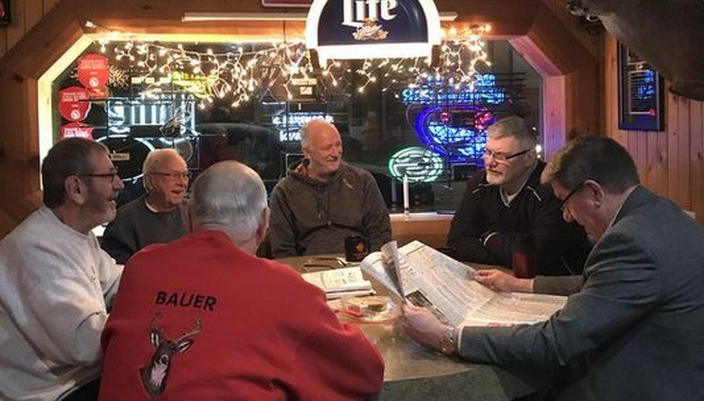 """The GOP tax plan is touted as a boost for the economy, but even people in """"Trump country,"""" such as this group in Mauston, Wis., have shown little enthusiasm for it. (Craig Gilbert/Milwaukee Journal Sentinel)"""